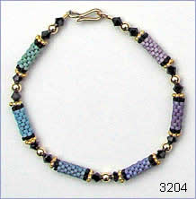 Green-blue-purple bracelet by Robin Atkins, bead artist.