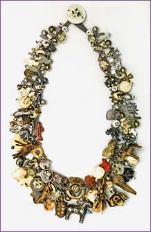 Critters, a woven treasure necklace featuring over 200 different animal beads and charms made from many different materials; necklace by Robin Atkins, bead artist