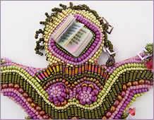 detail of head, Doll 2, one in a series of beaded dolls by Robin Atkins, bead artist