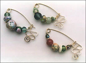 Three Fibula Pins by Robin Atkins, bead artist